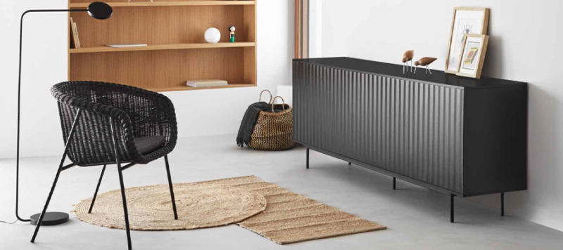 Black sideboard in a living room
