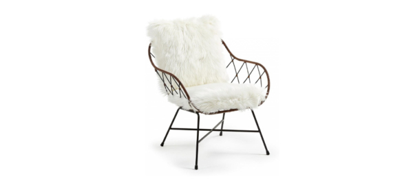 Living room chair with white cushions.