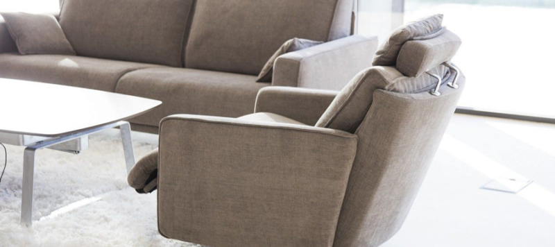 Side view of brown fama chair.