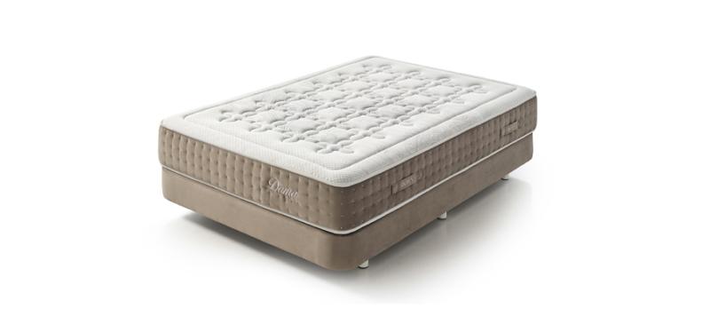 Dupen mattress on a bed.