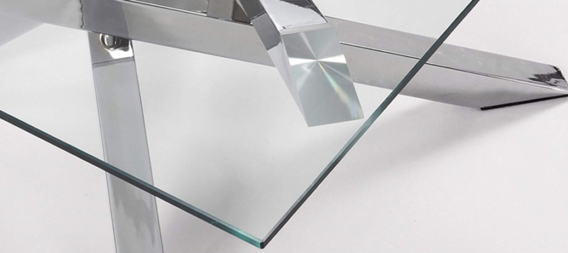 Glass top silver legs coffee table.