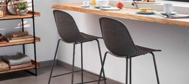 Dark grey bar stool near a bar table.