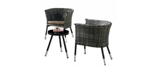 Black rattan outdoor armchairs with side table and black legs.