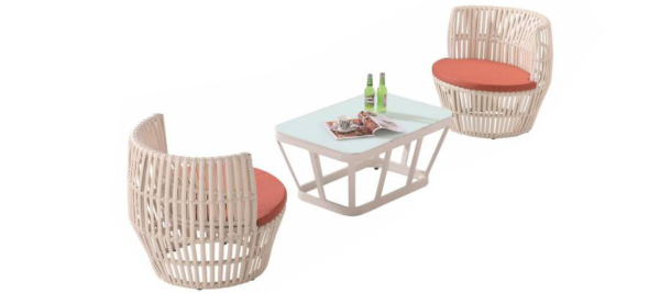 Two rattan with orange colour outdoor armchairs and a coffee table.