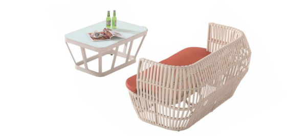Three Seater orange outdoor sofa with table.