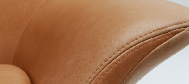 Close up of leather quality armchair.