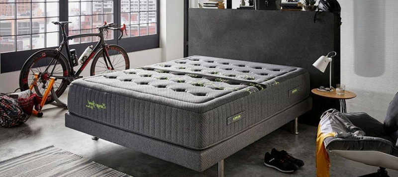 Energy sport mattress by dupen on a bed in a bedroom.