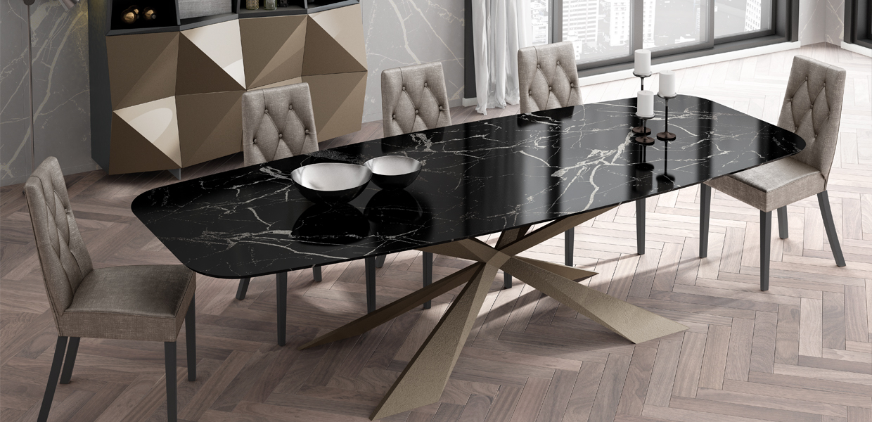 Franco elegant dining table with gold legs and black marble top and 5 dining chairs in a dining room.