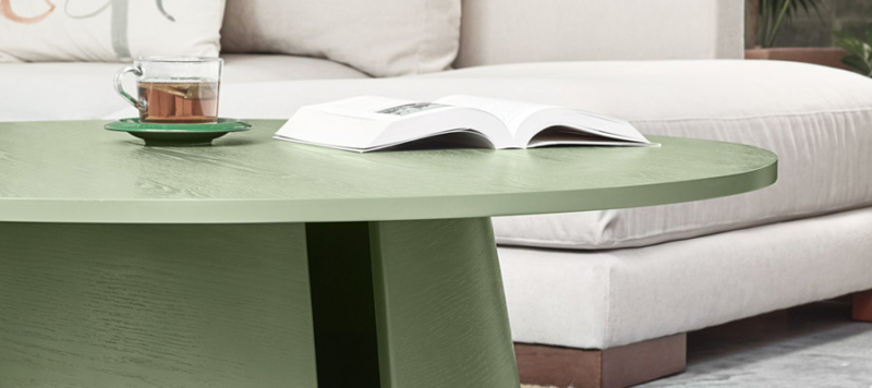 Book on a green coffee table.