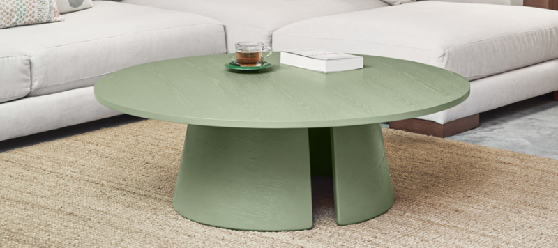 Green coffee table in a living room.