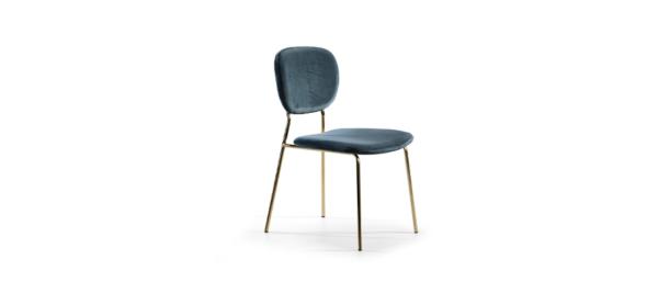Blue fabric gold legs chair.